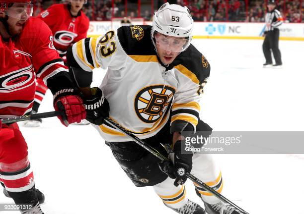 Brad Marchand of the Boston Bruins controls a puck on the corner during an NHL game against the Carolina Hurricanes on March 13 2018 at PNC Arena in...