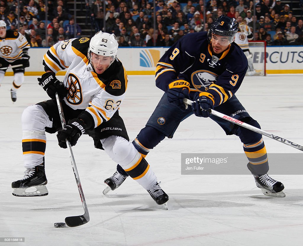 Brad Marchand #63 of the Boston Bruins controls the puck against Evander Kane #9 of the Buffalo Sabres at First Niagara Center on January 15, 2016 in Buffalo, New York.