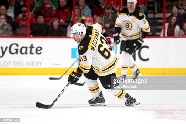 Brad Marchand of the Boston Bruins controls the puck on the ice during an NHL game against the Carolina Hurricanes on March 13 2018 at PNC Arena in...