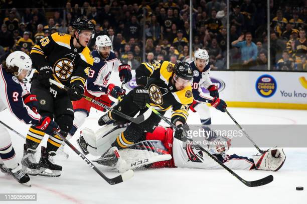 Brad Marchand of the Boston Bruins dives as he shoots the puck in the first period of a game against the Columbus Blue Jackets in Game One of the...