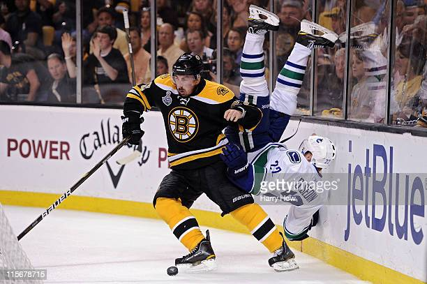 Brad Marchand of the Boston Bruins dodges Daniel Sedin of the Vancouver Canucks during Game Four of the 2011 NHL Stanley Cup Final at TD Garden on...