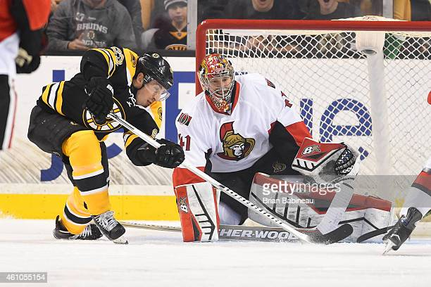 Brad Marchand of the Boston Bruins fights for the puck against Craig Anderson of the Ottawa Senators at the TD Garden on January 3 2015 in Boston...