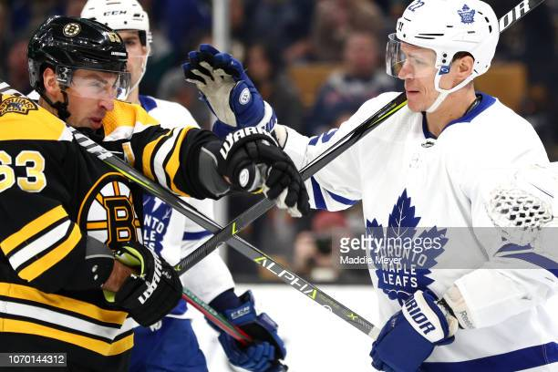 Brad Marchand of the Boston Bruins fights Nikita Zaitsev of the Toronto Maple Leafs during the first period of the game between the Boston Bruins and...