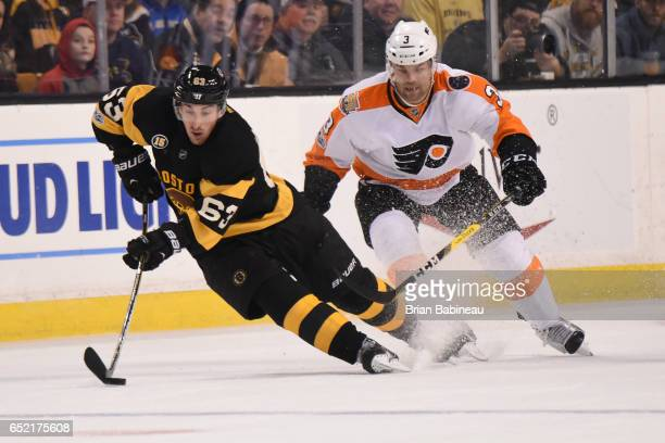 Brad Marchand of the Boston Bruins handles the puck against Radko Gudas of the Philadelphia Flyers at the TD Garden on March 11 2017 in Boston...