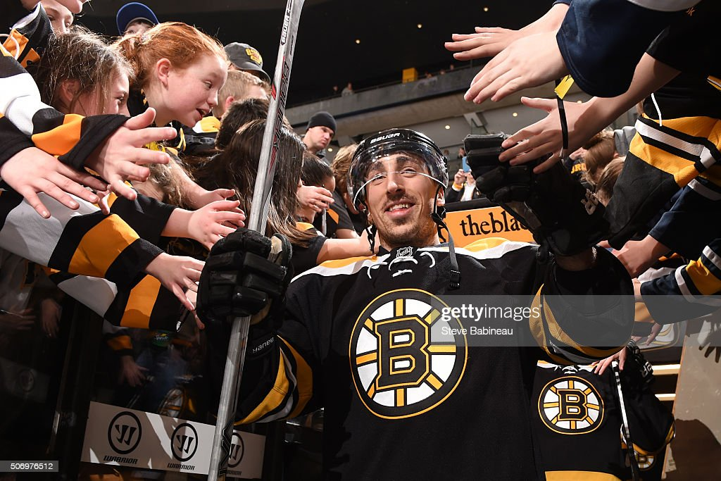 Brad Marchand #63 of the Boston Bruins high fives fans on his way to warm ups before the game against the Anaheim Ducks at the TD Garden on January 26, 2016 in Boston, Massachusetts.