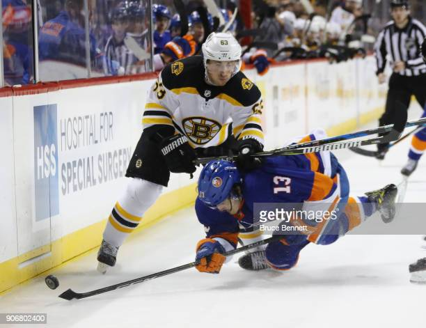 Brad Marchand of the Boston Bruins hits Mathew Barzal of the New York Islanders during the second period at the Barclays Center on January 18 2018 in...