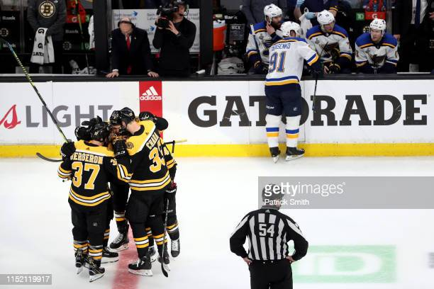 Brad Marchand of the Boston Bruins is congratulated by his teammates after scoring a third period emptynet goal against the St Louis Blues in Game...