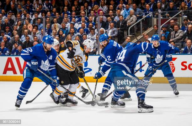 Brad Marchand of the Boston Bruins is defended by Auston Matthews Ron Hainsey Patrick Marleau and Mitchell Marner of the Toronto Maple Leafs in Game...
