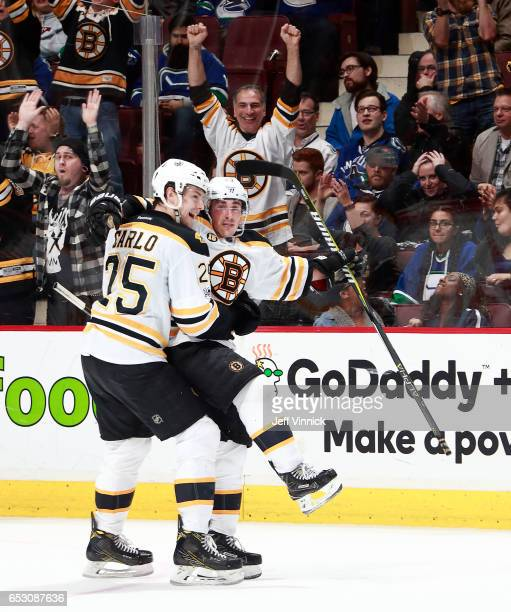 Brad Marchand of the Boston Bruins is hugged by teammate Brandon Carlo after scoring during their NHL game against the Vancouver Canucks at Rogers...