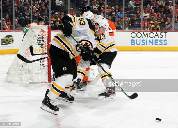 Brad Marchand of the Boston Bruins passes the puck against the Philadelphia Flyers on March 10 2020 at the Wells Fargo Center in Philadelphia...
