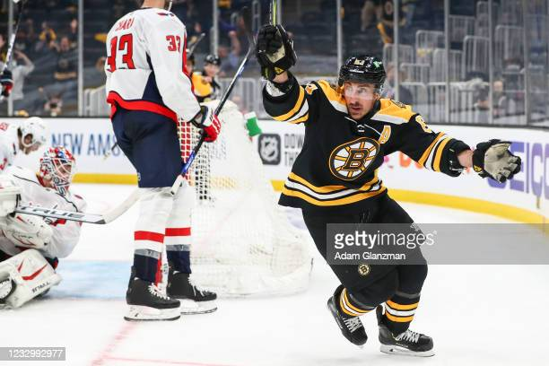 Brad Marchand of the Boston Bruins reacts after scoring in the third period against the Washington Capitals in Game Three of the First Round of the...