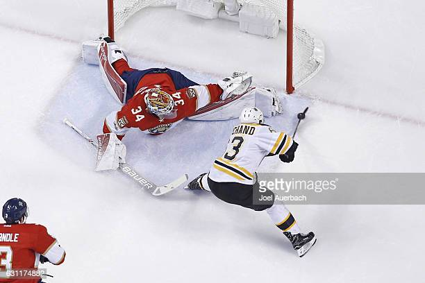 Brad Marchand of the Boston Bruins scores a first period goal past Goaltender James Reimer of the Florida Panthers during first period action at the...