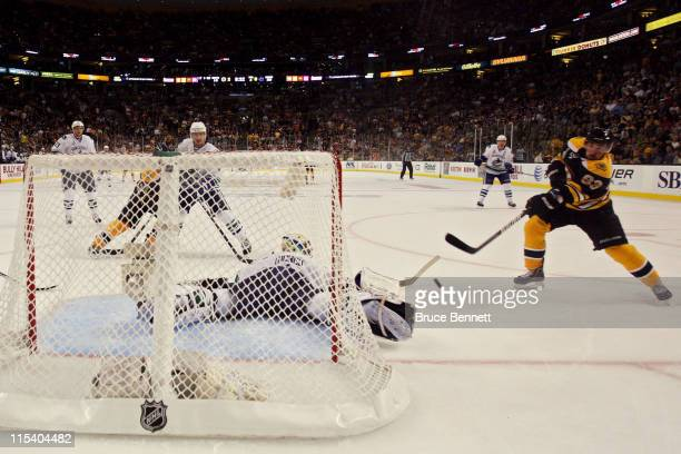 Brad Marchand of the Boston Bruins scores a goal in the second period against Roberto Luongo of the Vancouver Canucks during Game Three of the 2011...