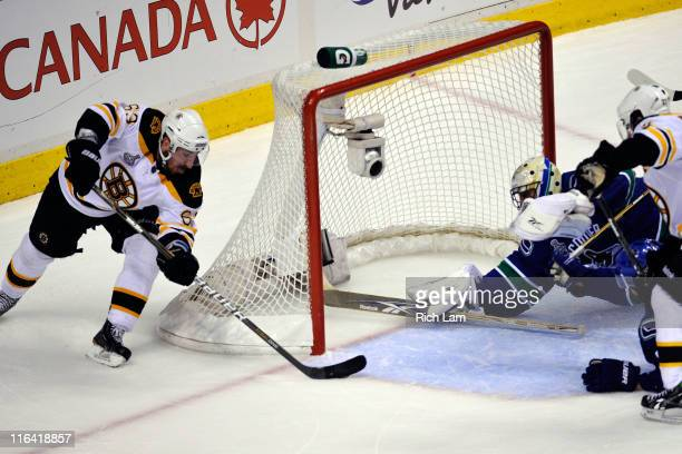 Brad Marchand of the Boston Bruins scores a goal in the second period against Roberto Luongo of the Vancouver Canucks during Game Seven of the 2011...