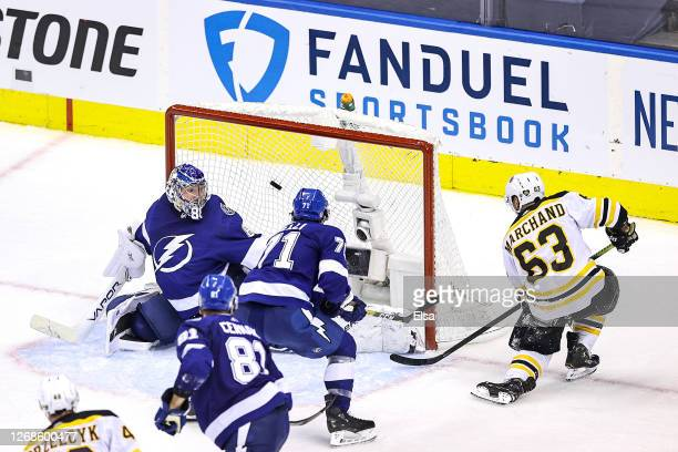 Brad Marchand of the Boston Bruins scores a goal past Andrei Vasilevskiy of the Tampa Bay Lightning during the third period in Game Two of the...