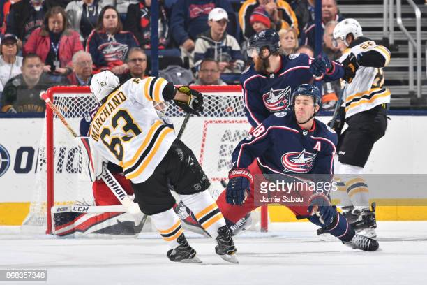 Brad Marchand of the Boston Bruins scores his 200th career NHL goal on goaltender Sergei Bobrovsky of the Columbus Blue Jackets during the third...