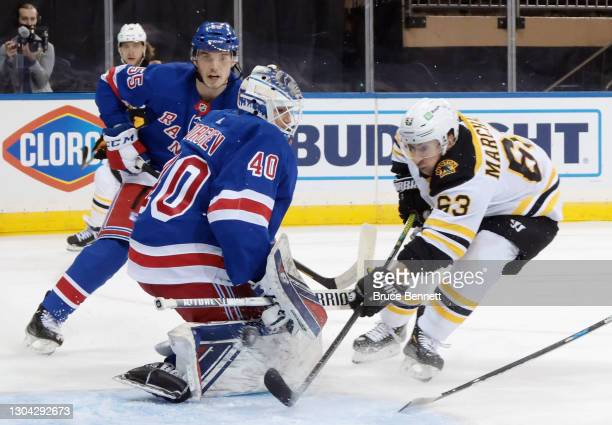 Brad Marchand of the Boston Bruins scores his 300th career goal at 7:51 of the third period against Alexandar Georgiev of the New York Rangers at...