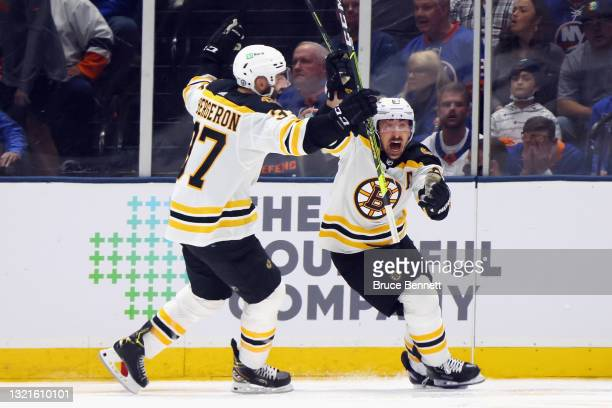 Brad Marchand of the Boston Bruins scores the game-winning goal at 3:36 of overtime against the New York Islanders in Game Three of the Second Round...