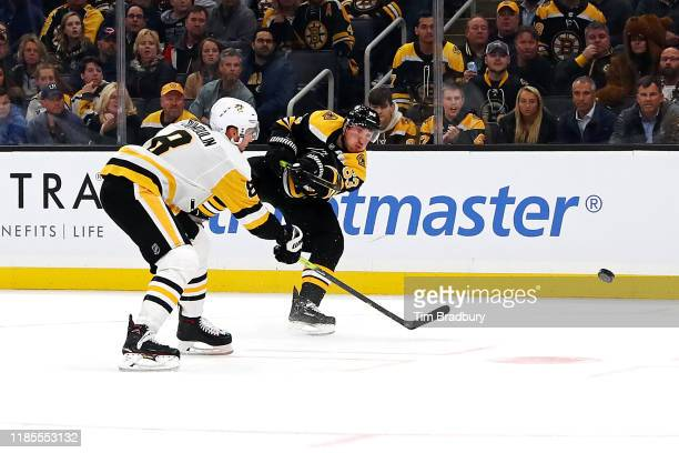 Brad Marchand of the Boston Bruins scores the goahead goal during the third period against the Pittsburgh Penguins at TD Garden on November 04 2019...