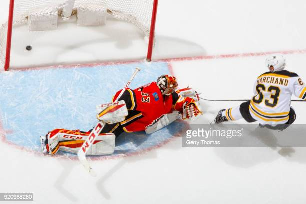 Brad Marchand of the Boston Bruins scores the winning goal against David Rittich of the Calgary Flames in an NHL game on February 19 2018 at the...