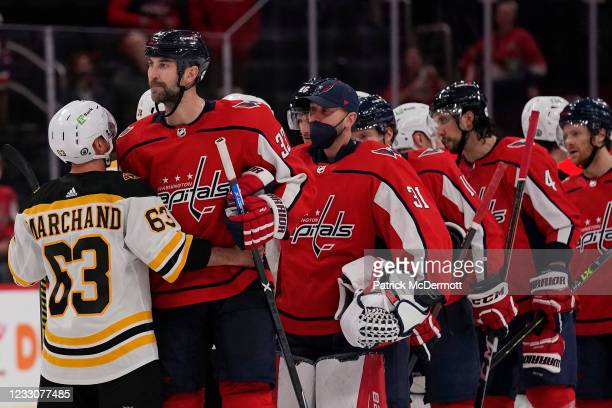 Brad Marchand of the Boston Bruins shakes hands with Zdeno Chara of the Washington Capitals after the Bruins defeated the Capitals 3-1 in Game Five...
