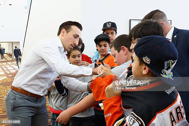 Brad Marchand of the Boston Bruins signs autographs for young fans during 2017 NHL AllStar Media Day as part of the 2017 NHL AllStar Weekend at the...