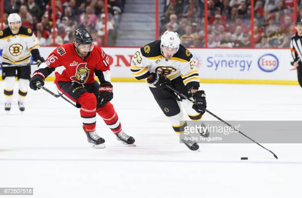 Brad Marchand of the Boston Bruins skates against Clarke MacArthur of the Ottawa Senators in Game Five of the Eastern Conference First Round during...