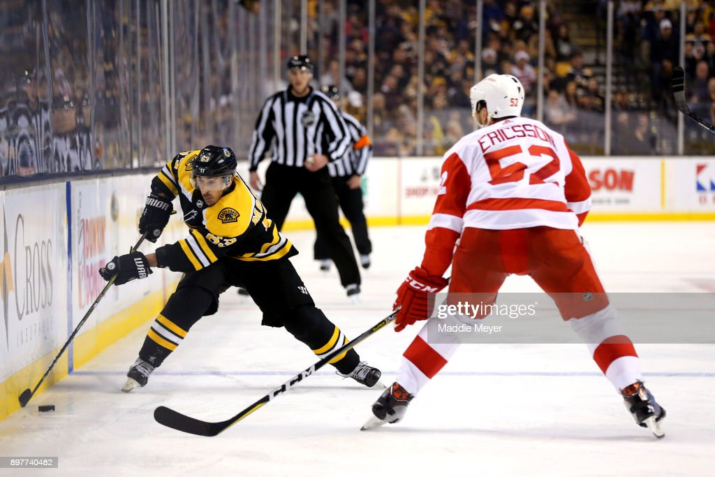 Brad Marchand #63 of the Boston Bruins skates against Jonathan Ericsson #52 of the Detroit Red Wings during the third period at TD Garden on December 23, 2017 in Boston, Massachusetts. The Bruins defeat the Red Wings 3-1.