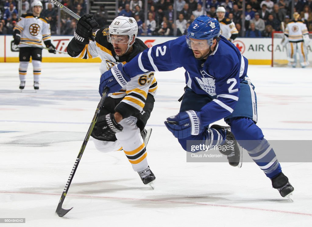 Brad Marchand #63 of the Boston Bruins skates against Ron Hainsey #2 of the Toronto Maple Leafs in Game Six of the Eastern Conference First Round in the 2018 Stanley Cup Play-offs at the Air Canada Centre on April 23, 2018 in Toronto, Ontario, Canada. The Maple Leafs defeated the Bruins 3-1.