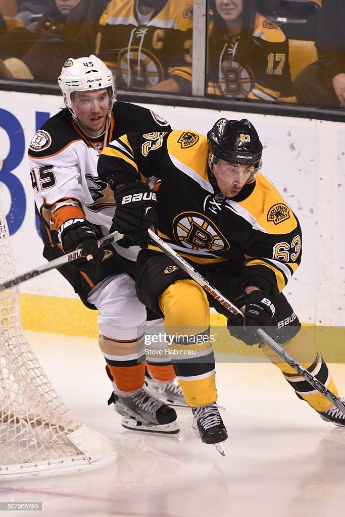 Brad Marchand #63 of the Boston Bruins skates against Sami Vatanen #45 of the Anaheim Ducks at the TD Garden on January 26, 2016 in Boston, Massachusetts.