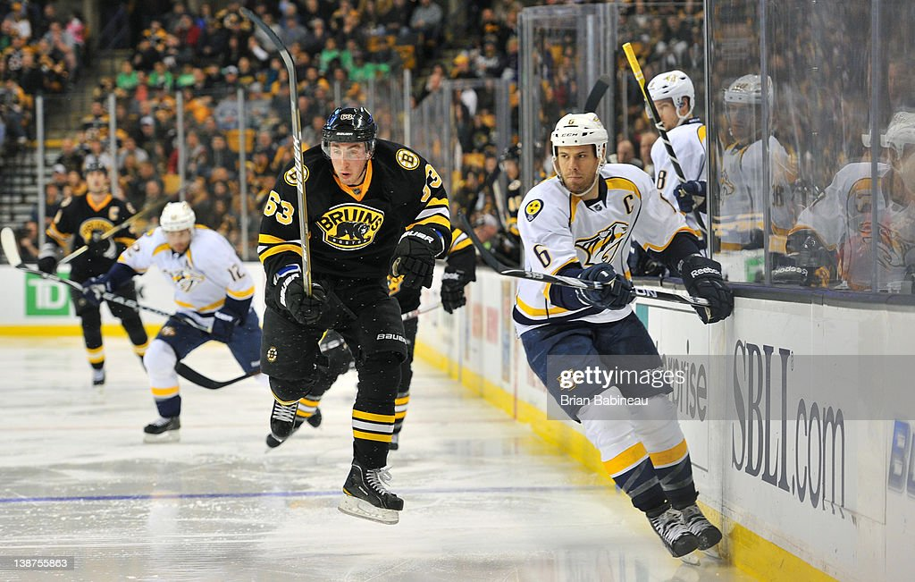 Brad Marchand #63 of the Boston Bruins skates against Shea Weber #6 of the Nashville Predators at the TD Garden on February 11, 2012 in Boston, Massachusetts.