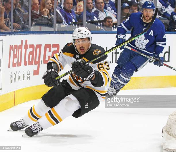 Brad Marchand of the Boston Bruins skates ahead of Morgan Rielly of the Toronto Maple Leafs in Game Six of the Eastern Conference First Round during...