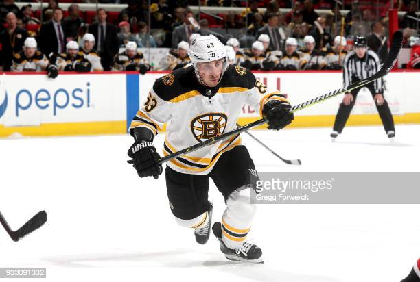 Brad Marchand of the Boston Bruins skates for position on the ice during a faceoff of an NHL game against the Carolina Hurricanes on March 13 2018 at...