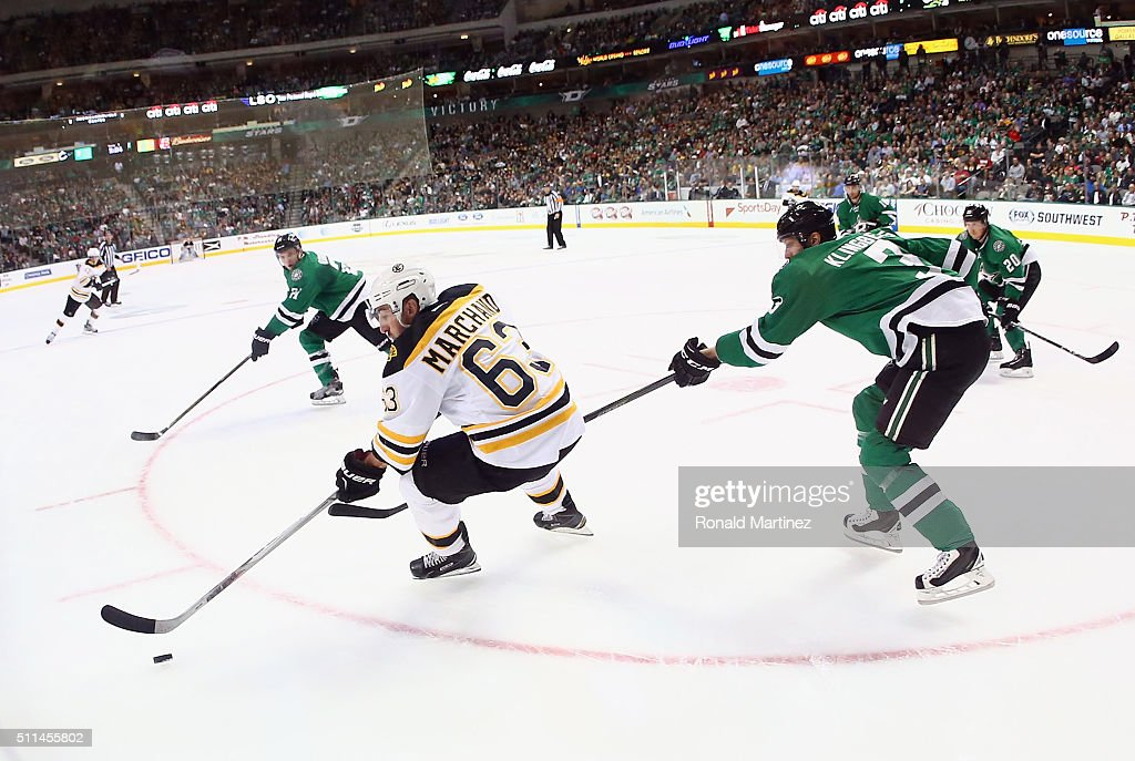 Brad Marchand #63 of the Boston Bruins skates the puck against John Klingberg #3 of the Dallas Stars in the second period at American Airlines Center on February 20, 2016 in Dallas, Texas.