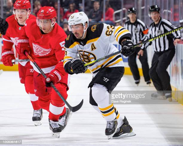 Brad Marchand of the Boston Bruins skates up ice next to Valtteri Filppula of the Detroit Red Wings during an NHL game at Little Caesars Arena on...