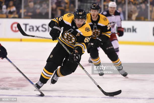 Brad Marchand of the Boston Bruins skates with the puck against the Columbus Blue Jackets at the TD Garden on March 19 2018 in Boston Massachusetts