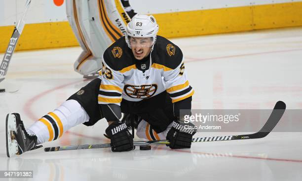 Brad Marchand of the Boston Bruins stretches during the warmup prior to playing against the Toronto Maple Leafs in Game Three of the Eastern...