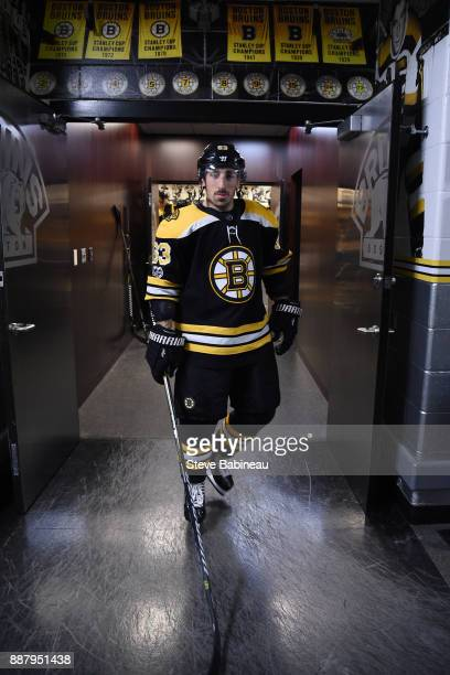 Brad Marchand of the Boston Bruins walks out of the locker room for warm ups before the game against the Arizona Coyotes at the TD Garden on December...