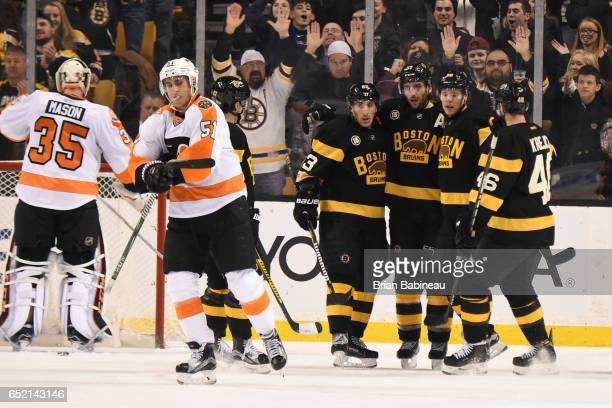 Brad Marchand Patrice Bergeron David Pastrnak and David Krejci of the Boston Bruins celebrate a goal against the Philadelphia Flyers at the TD Garden...