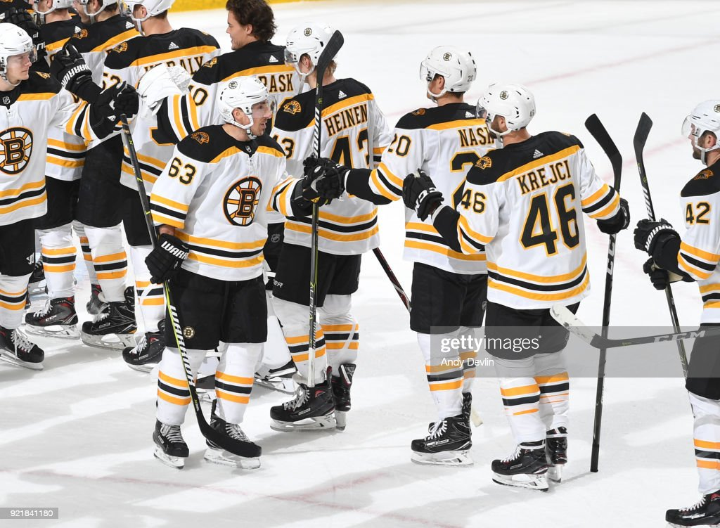 Brad Marchand #63, Riley Nash #20 and David Krejci #46 of the Boston Bruins celebrate after winning the game against the Edmonton Oilers on February 20, 2018 at Rogers Place in Edmonton, Alberta, Canada.