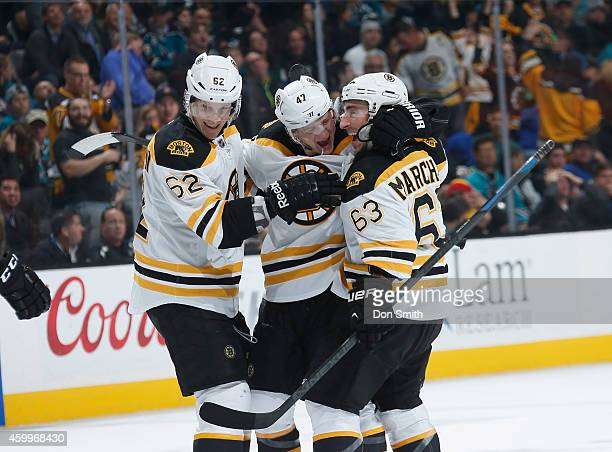 Brad Marchand, Torey Krug and Zach Trotman of the Boston Bruins celebrate a goal against the Boston Bruins during an NHL game on December 4, 2014 at...