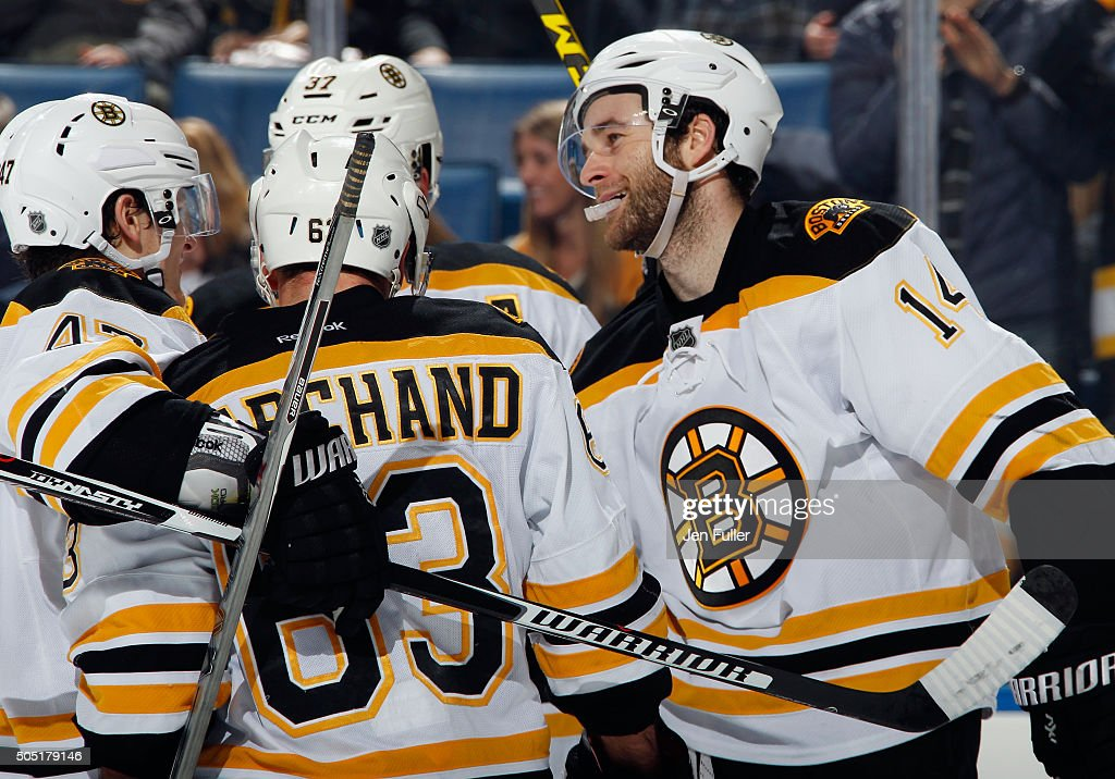 Brad Marchand #63, Torey Krug #47, Patrice Bergeron #37 and Brett Connolly #14 of the Boston Bruins celebrate a goal against the Buffalo Sabres at First Niagara Center on January 15, 2016 in Buffalo, New York. Boston defeated Buffalo 4-1.