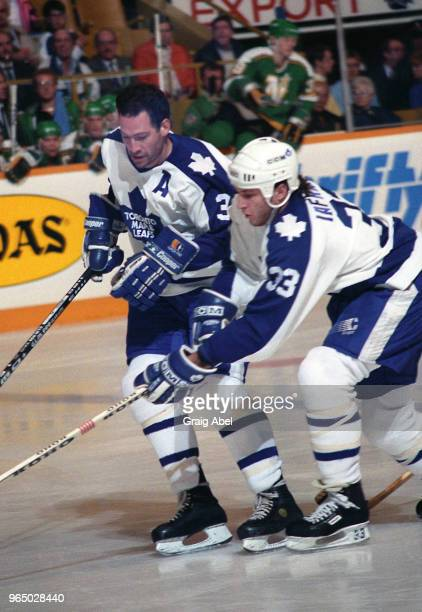 Brad Marsh and Al Iafrate of the Toronto Maple Leafs skate against the Minnesota North Stars during NHL game action November 6 1989 at Maple Leaf...