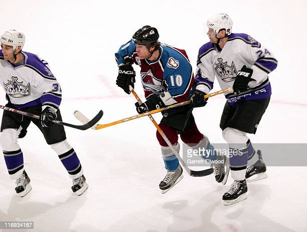 Brad May of the Colorado Avalanche skates between Pavol Demitra left and Alexander Frolov of the Los Angeles Kings during the game between the Los...