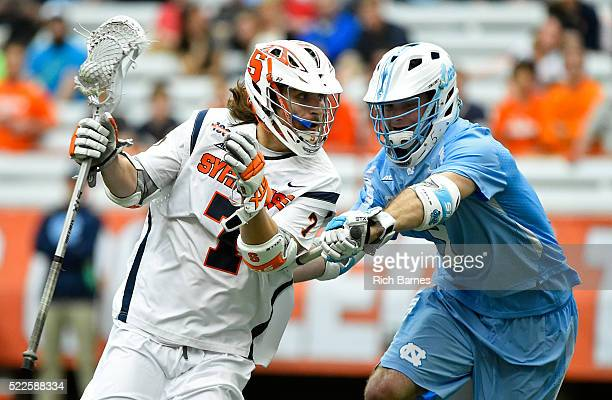 Brad McKinney of the Syracuse Orange dodges to the goal against the defense of Brett Bedard of the North Carolina Tar Heels during the second quarter...