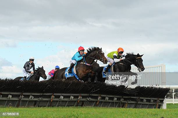 Brad McLean riding Tusan Fire and Paul Hamblin riding Stand To Gain in Race 6 the Galleywood Hurdle during Brierly Day at Warrnambool Race Club on...