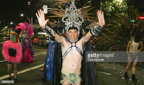 Brad Merriel waves at the crowd on Oxford street during the 2006 Sydney New Gay and Lesbian Mardi Gras parade March 4 2006 in Sydney Australia The...