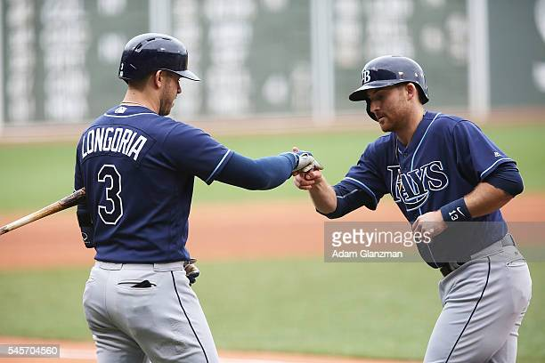 Brad Miller celebrates with Evan Longoria of the Tampa Bay Rays after hitting a solo home run in the first inning of against the Boston Red Sox at...