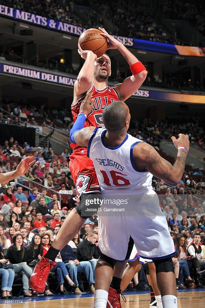 Brad Miller #52 of the Chicago Bulls shoots against Marreese Speights #16 of the Philadelphia 76ers during the game on March 20, 2010 at the Wachovia Center in Philadelphia, Pennsylvania. The Bulls won 98-84.