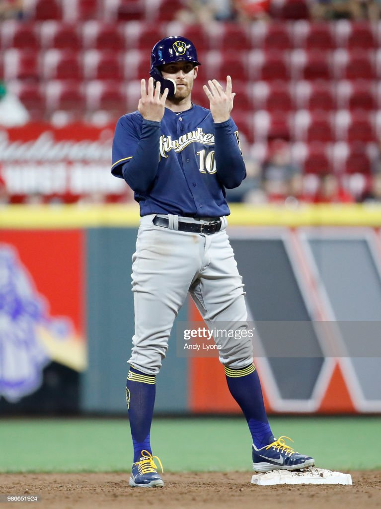 Brad Miller #10 of the Milwaukee Brewers celebrates after hitting a double in the 9th inning against the Cincinnati Reds at Great American Ball Park on June 28, 2018 in Cincinnati, Ohio.